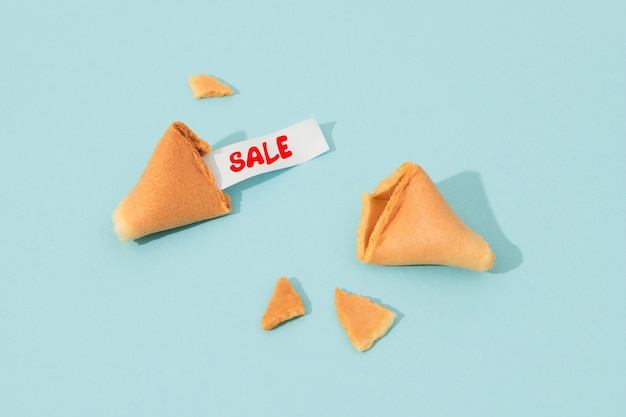 Creative composition with fortune cookie and paper with text on blue background