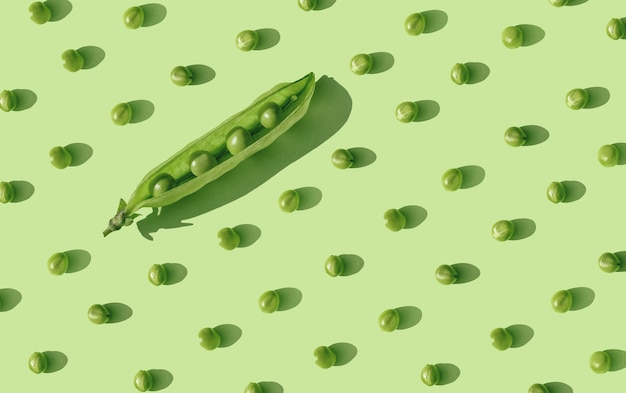 Creative concept of social distancing in the form of green pea seeds lying at a safe distance. keep distance in public society people to protect covid-19 coronavirus outbreak spreadingk