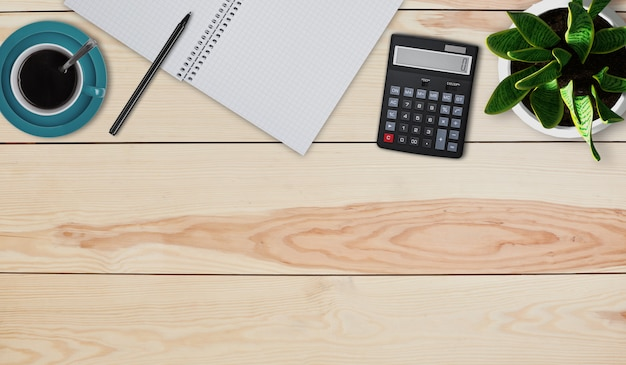 Creative design mockup set of workspace desk. top view of home desktop. calculator, mug with coffee or tea, pot with flower, notebook and pen laying on wooden background. calculating figures at home