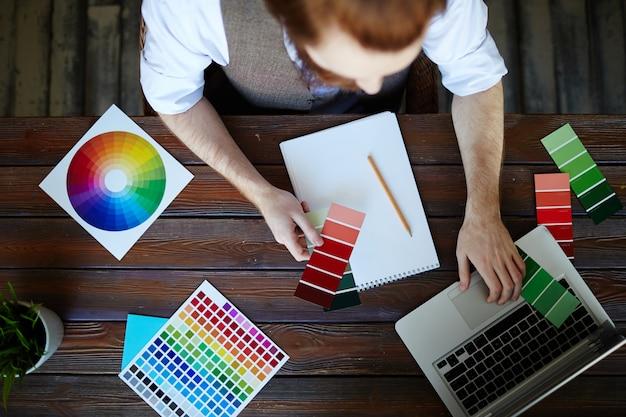 Creative designer choosing color scheme