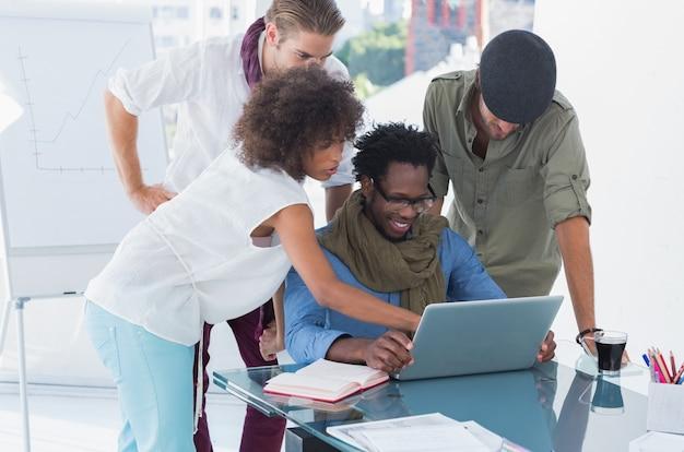 Creative designers using laptop
