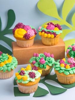 Creative dessert muffin with colorful cream decoration