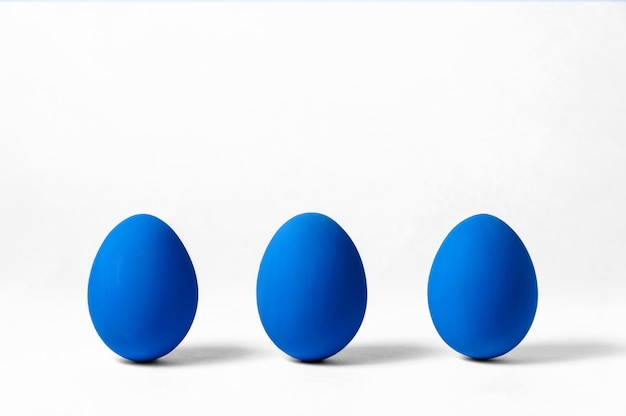 Creative easter  . three eggs on white. minimalism concept. trendy color of year - classic blue. copy space