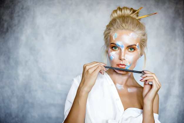 Creative fashion beauty portrait of beautiful young blonde woman with hairstyle.