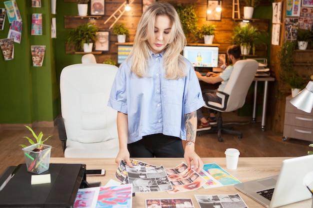 現代のオフィスで働く創造的な女性の洋裁。スタイリッシュな服を着た女性。