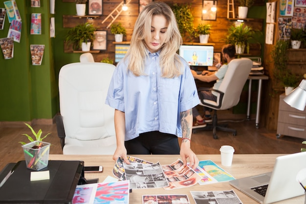 Creative female dressmaker working in a modern office. woman in stylish clothes.
