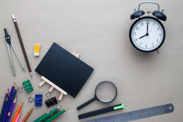 Creative flat lay back to school concept with stationary on workspace desk