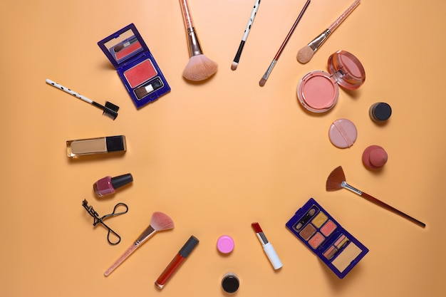 Creative flat lay composition of make up set with copy space