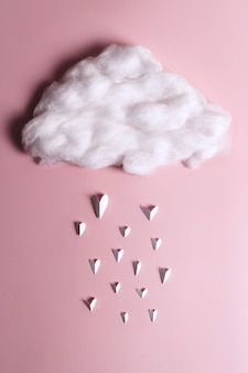 Creative flat lay of heart shape objects falling from the cloud