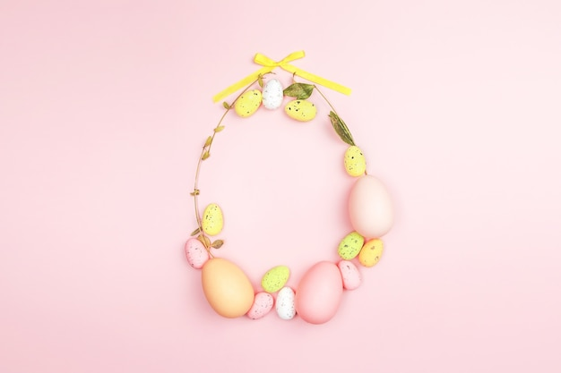Creative flat lay photo of easter eggs on colorful background.
