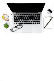 Creative flat lay photo of modern workplace with laptop, top view laptop background and copy space