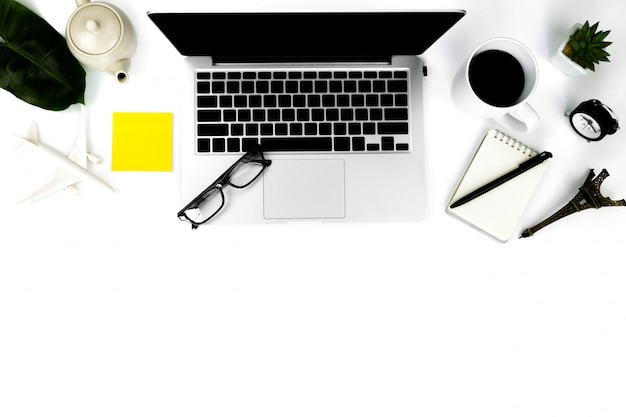 Creative flat lay photo of modern workplace with laptop on white background