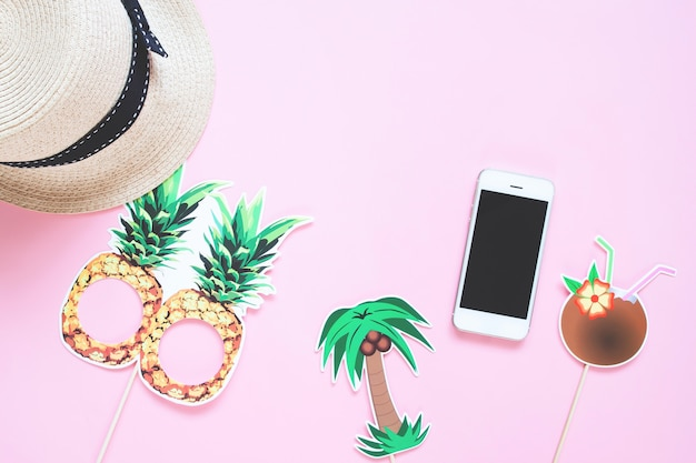 Creative flat lay of summer concept with smart phone on colour background