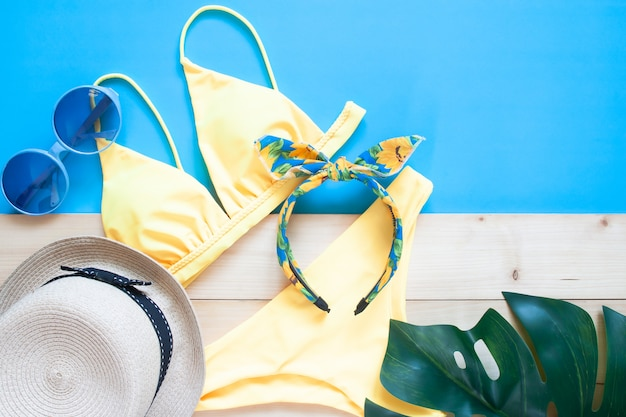 Creative flat lay of trendy bikini and summer accessories. travel vacation concept