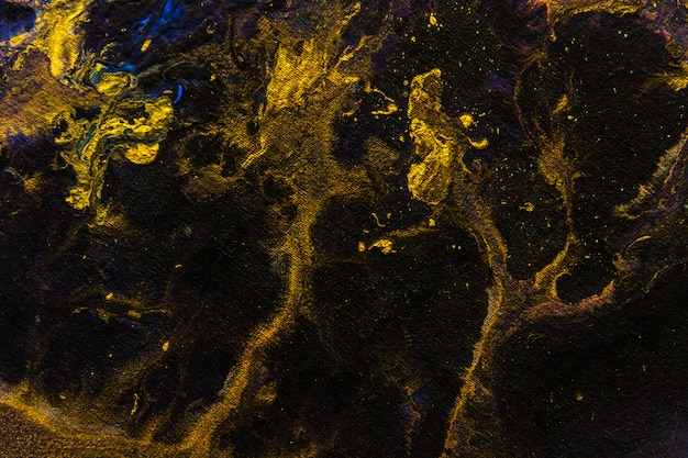 Creative gold black abstract hand painted background wallpaper texture design close-up fragment motion stains of fluid acrylic watercolor oil painting picture canvas modern contemporary piece of art