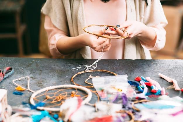 Creative hobby. woman making dreamcatcher