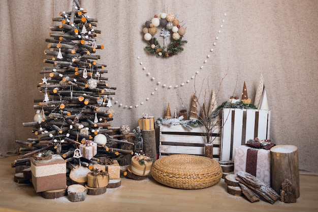 Creative interior with a wooden chistmas tree and other new year decor