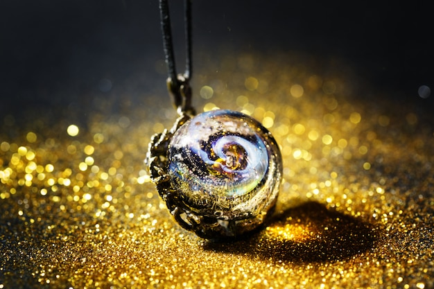 Creative jewelry made from glass with universe inside bead