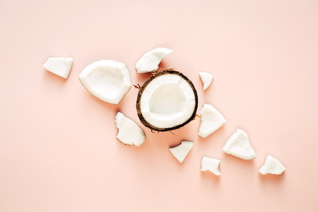 Creative layout. flat lay. food concept. coconut on pink background.