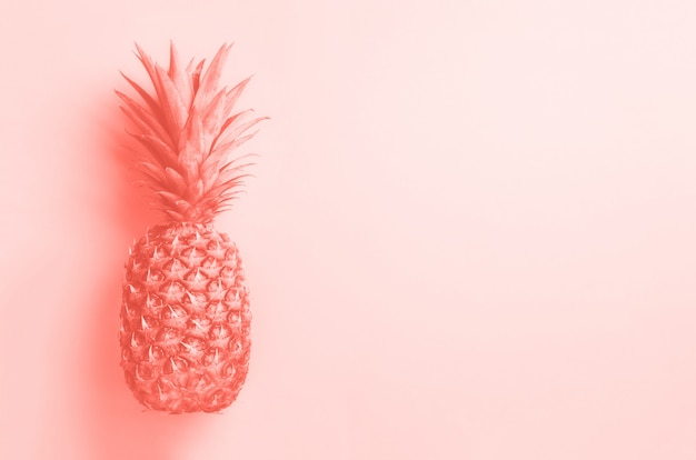 Creative layout. gold pineapple on grey background with copy space. top view. tropical flat lay. exotic food concept, crazy trend