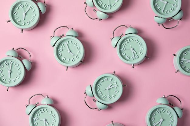 Creative layout of green alarm clock's