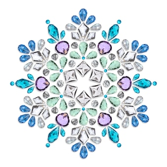 Creative layout of jewelry. the mandala is made of different gemstones on white background.