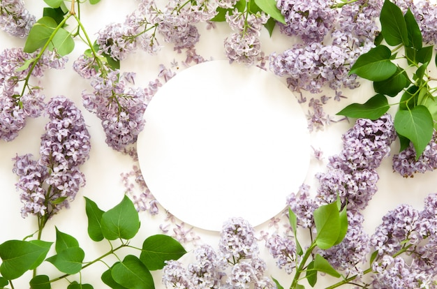 Creative layout of lilac flowers with white paper. mockup. view from above.