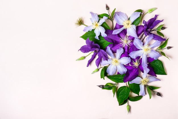 Creative layout made with purple flowers. holiday greeting mockup.