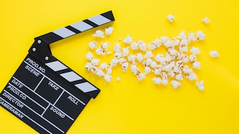Creative layout of clapperboard and popcorn