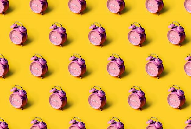 Creative layout of pink alarm clock's
