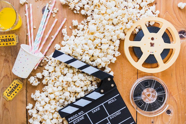 Creative layout of popcorn and cinema objects