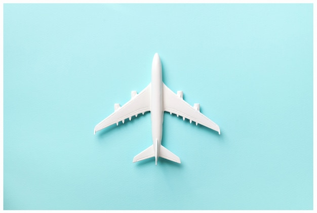 Creative layout. top view of white model plane, airplane toy on pink pastel background.