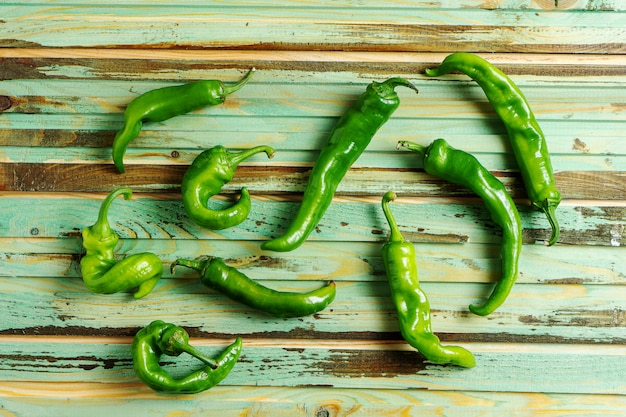 Creative layout with hot pepper on wooden background