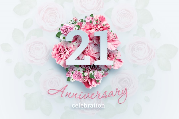 Creative lettering 21 numbers and anniversary celebration text on pink flowers. anniversary concept, adulthood, birthday, celebration event, template, flyer