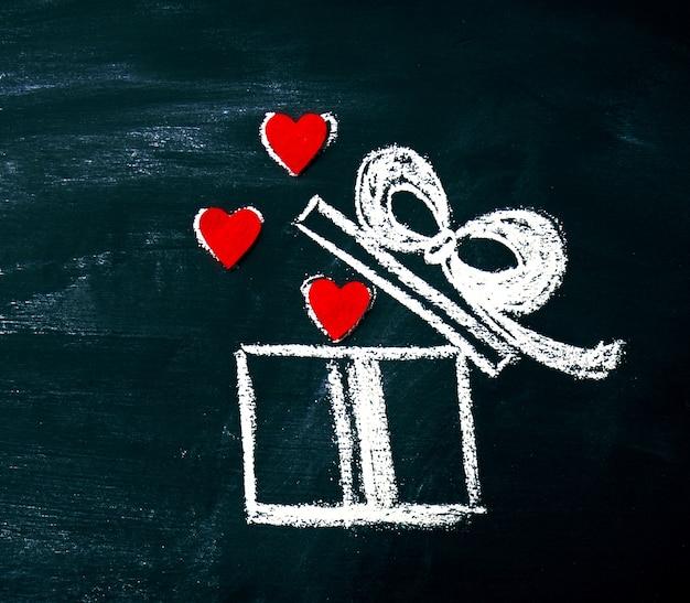 Творческая любовь или день святого валентина концепция с подарочной коробке и сердца