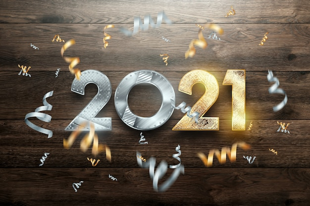 Creative luxury lettering 2021 with metal numbers on wooden background.