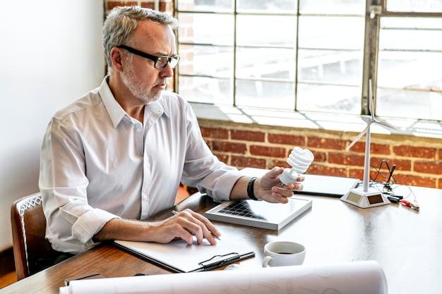Creative man holding a light bulb