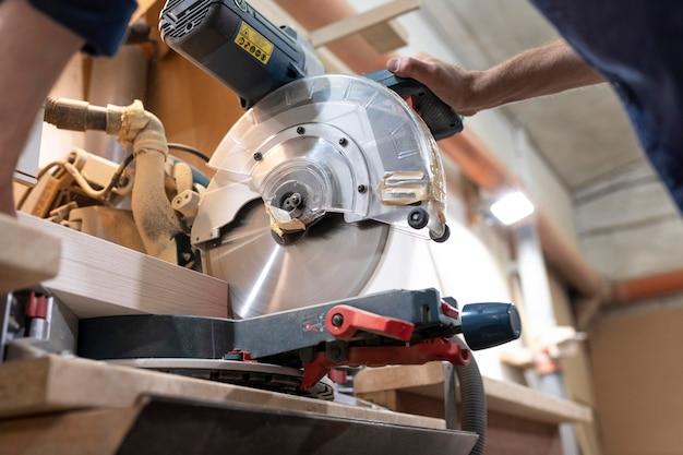 Creative man working in a wood workshop
