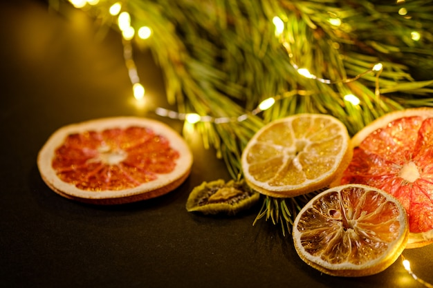 Creative moody holiday christmas new year dried citrus fruits