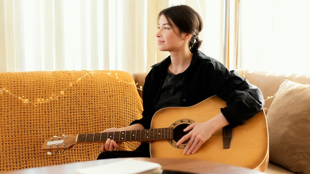 Creative musician practicing indoors