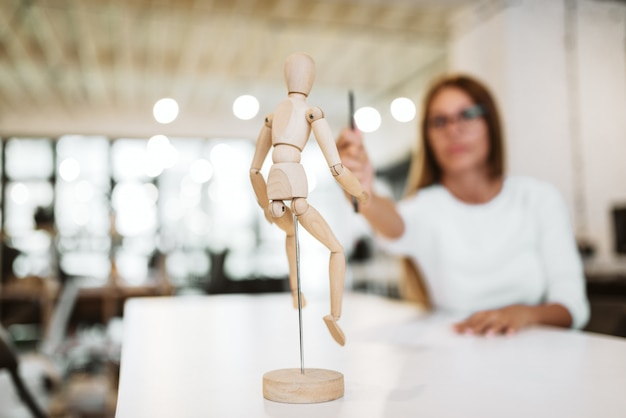 Creative occupation concept. drawing wooden mannequin.