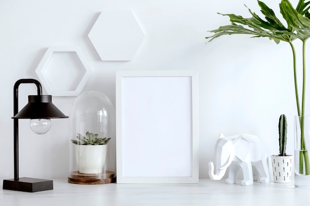 Creative office desk with white mock up frame cacti suculent black lamp geometric accessories