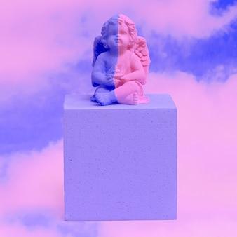 Creative painted angel souvenir in heaven. minimal visual art