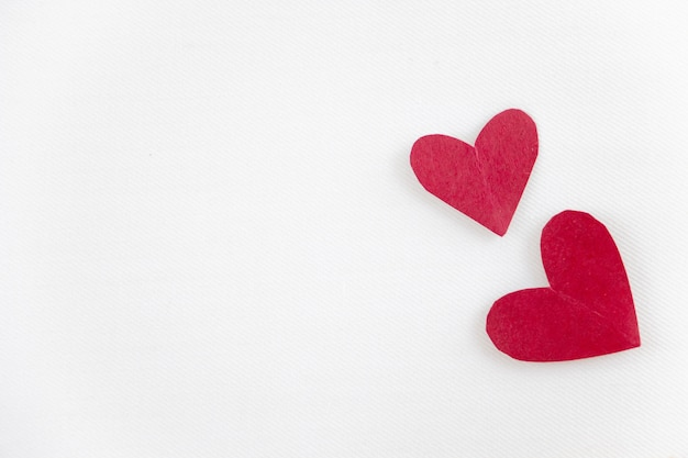 Creative paper red hearts on paper