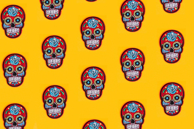 The creative pattern is made of katrina's skull and a yellow background. day of the dead is a mexican holiday