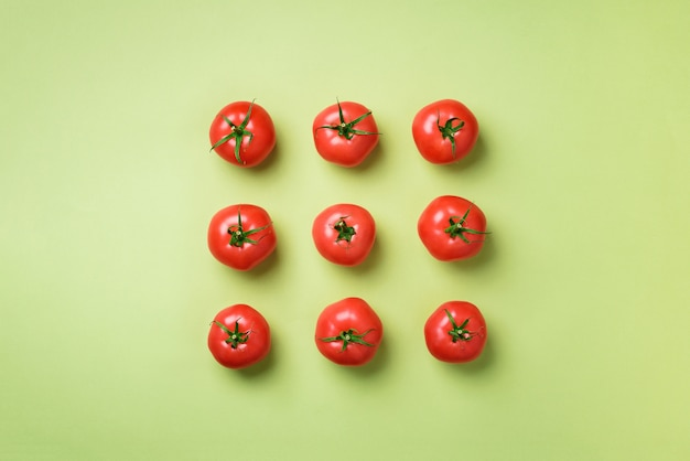 Creative pattern of red tomatoes. minimal design. vegetarian, vegan, organic food and alkaline meal concept