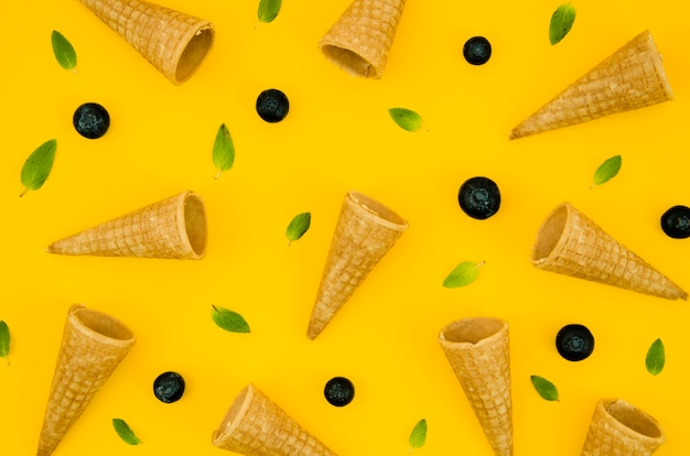 Creative pattern with blueberry and waffle cones