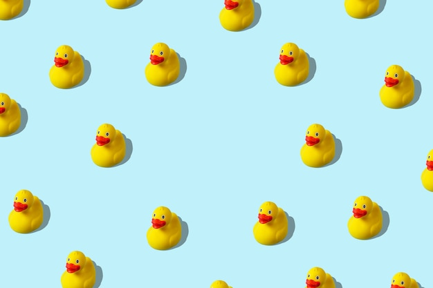 Creative pattern with rubber duck on blue background.