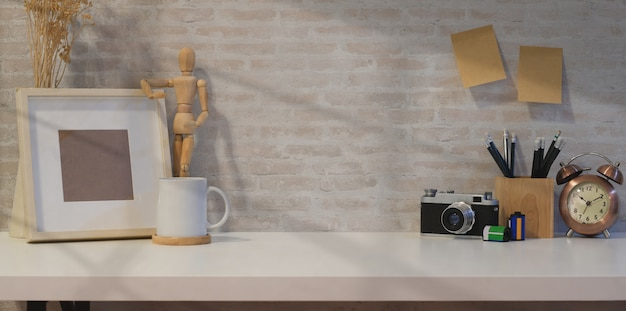 Creative photographer workplace with mock up frame