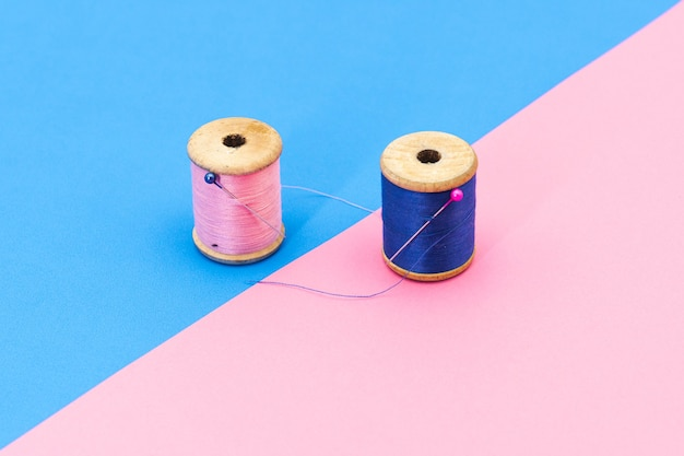 Creative picture of spools of sewing thread with needles